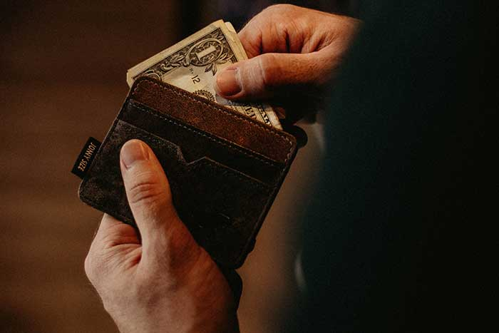 Man taking money from wallet